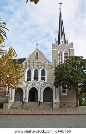 Beautiful small town church with bell tower - stock photo