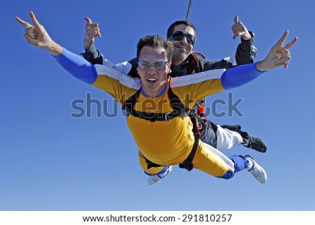 Beautiful smiles Skydiving. - stock photo