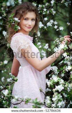 beautiful smiley model posing in white flowers - stock photo