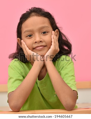 Beautiful smiling asian girl on bed. - stock photo