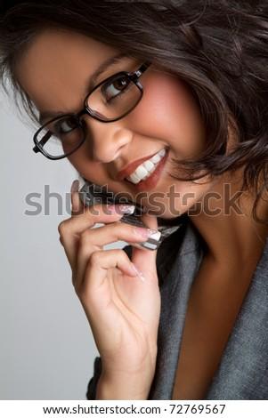 Beautiful smiling asian phone woman - stock photo