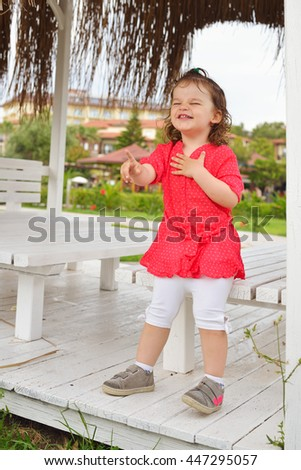 Beautiful smiling baby emotions. Cute toddler girl laughting a lot. - stock photo