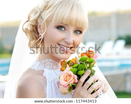 beautiful smiling bride - stock photo