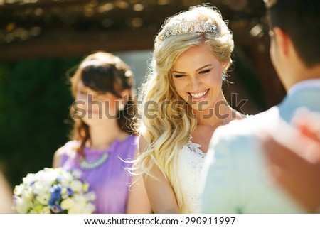 Beautiful smiling bride on wedding ceremony - stock photo