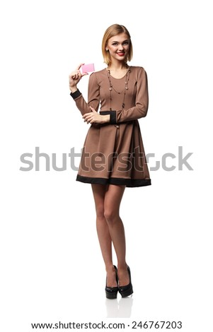 Beautiful smiling business woman, holding a card in hand, isolated on white background! - stock photo