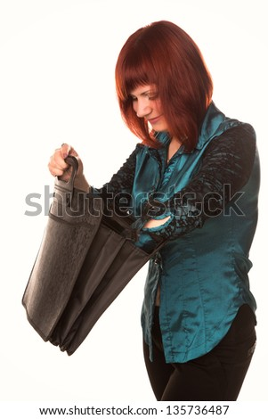 Beautiful smiling business woman looking for something in black briefcase isolated on white background - stock photo
