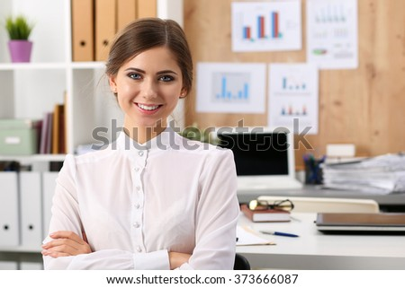 Beautiful smiling businesswoman standing in office with hands crossed on chest portrait. Serious business, exchange market, job offer, excellent education, certified public accountant concept - stock photo