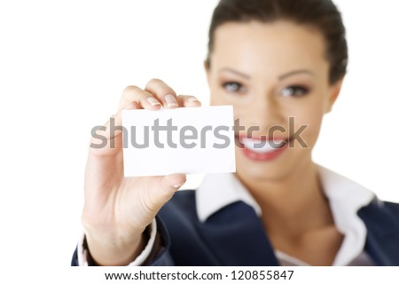 Beautiful smiling businesswoman with businesscard. Isolated on white - stock photo