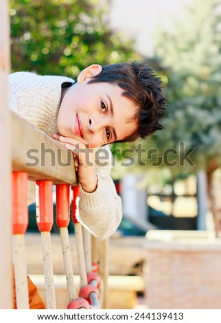 Beautiful smiling child playing in park - stock photo