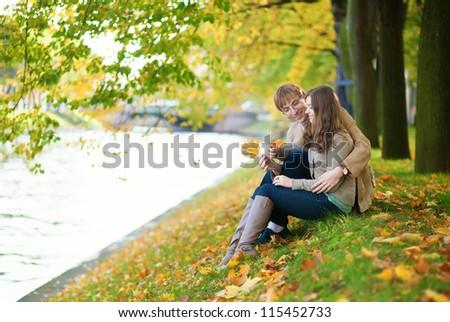 Beautiful smiling couple enjoying warm autumn day - stock photo