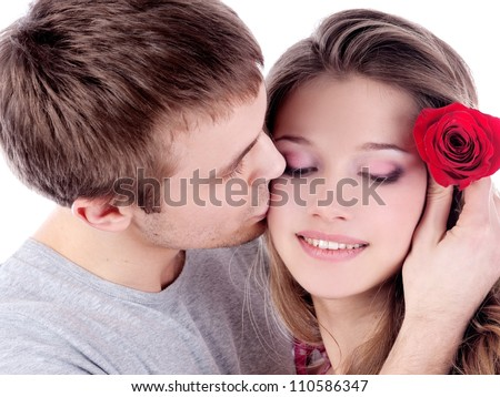 beautiful smiling couple with red rose on white background - stock photo