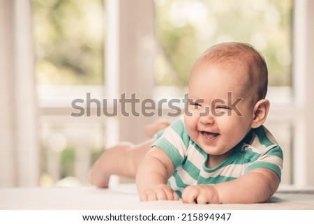 Beautiful smiling cute baby - stock photo