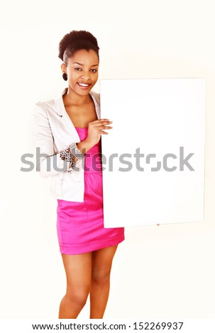 Beautiful smiling ethnic lady holding message board - stock photo