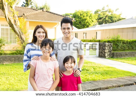 Beautiful smiling family portrait  outside their  house - stock photo