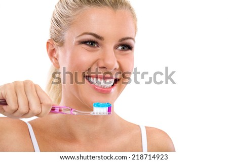 Beautiful smiling girl brushing healthy  teeth - stock photo