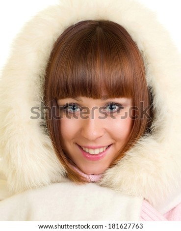 Beautiful smiling girl in warm clothes - stock photo