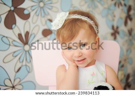 beautiful smiling girl touching her cheek - stock photo