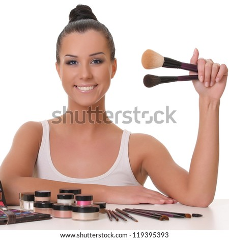 beautiful smiling girl with brushes - stock photo
