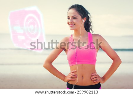 Beautiful smiling healthy with earphones on beach against fitness interface - stock photo