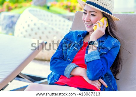 Beautiful smiling Lady Hipter talking on the mobile phone - stock photo