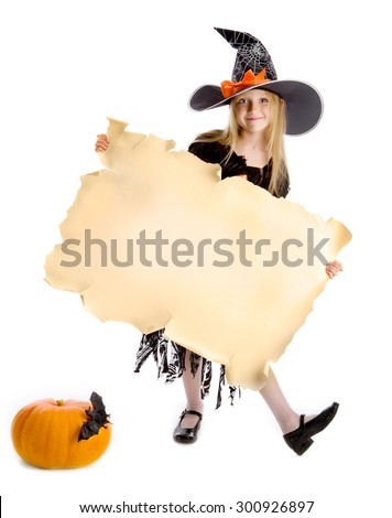 Beautiful smiling little girl with long blonde hair in the witch costume holding the parchment. Black witch hat with spider's web, spider and orange ribbon, Copy space. - stock photo