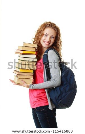 beautiful smiling student girl holding pile of books - stock photo