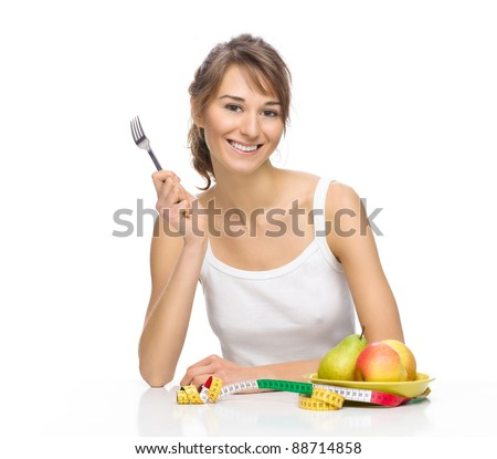 Beautiful smiling woman and fresh fruits - stock photo
