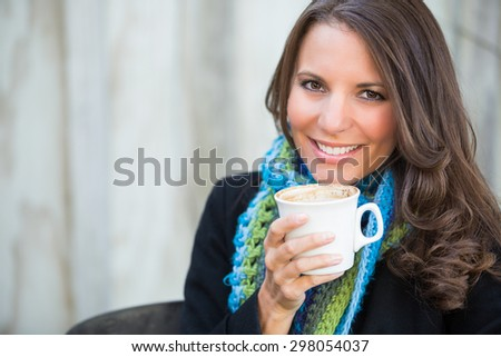 Beautiful smiling woman drinking cup of coffee - stock photo