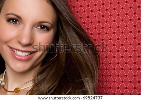 Beautiful smiling woman face closeup - stock photo