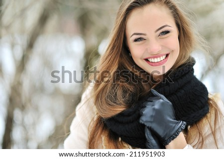 Beautiful smiling woman face outdoor portrait - stock photo