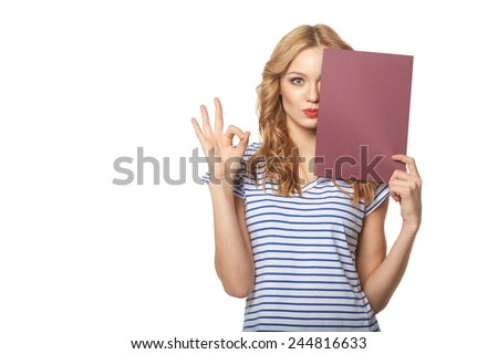 Beautiful smiling woman holding a blank billboard, isolated on a white background - stock photo
