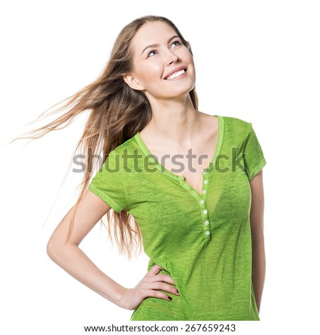 Beautiful smiling woman in green t-shirt looking up isolated on white - stock photo