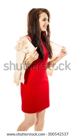 Beautiful smiling woman in red dress. Side view. Isolated on a white background. - stock photo