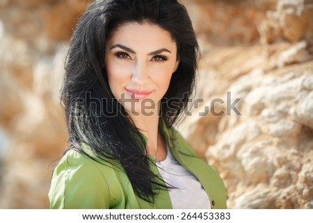 Beautiful smiling woman spring nature pretty girl outdoors spring portrait. Smiling female casual style. series.  - stock photo
