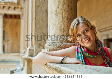 beautiful smiling woman tourist at Santa Maria della Pace Church in Rome, Italy - stock photo