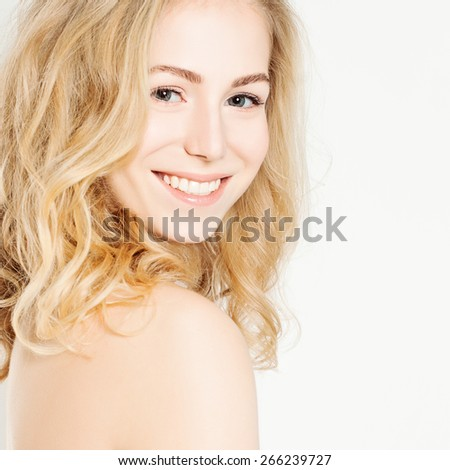 Beautiful Smiling Woman. White Teeth. Makeup. Hairstyle - stock photo