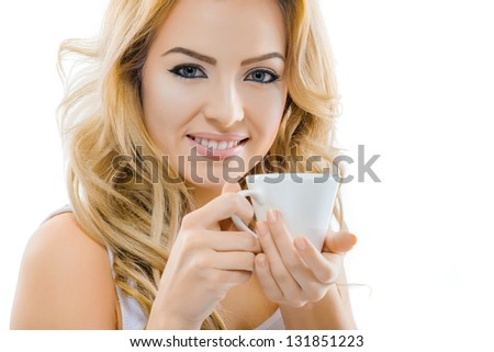 Beautiful smiling woman with a cup of coffee - stock photo