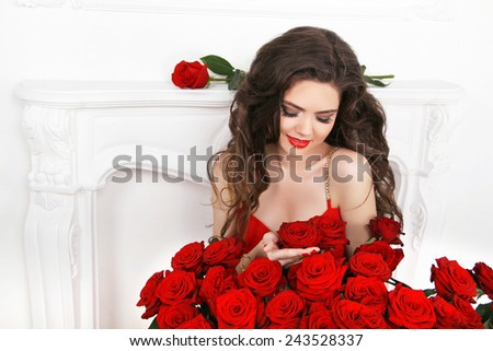 Beautiful smiling woman with makeup, red roses bouquet of flower. Fashion woman portrait. Valentines day. - stock photo