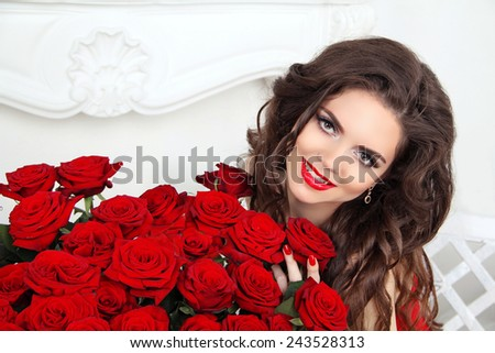 Beautiful smiling woman with makeup, red roses bouquet of flowers. Fashion girl portrait. Valentines day. - stock photo