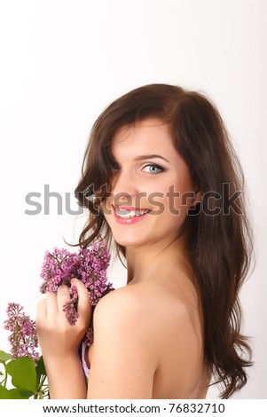 Beautiful, smiling women with lilac flowers and with purple makeup isolated on white background - stock photo