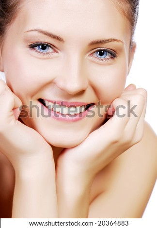 Beautiful smiling young adult teen face with hand at face - stock photo