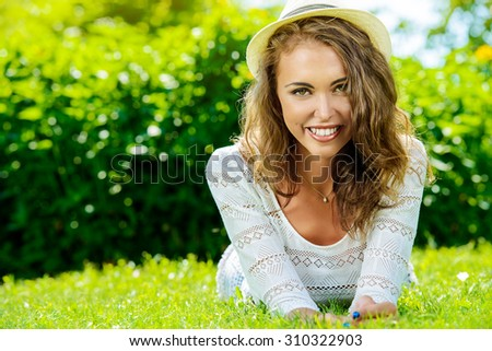 Beautiful smiling young woman outdoors. Happy sunny day.  - stock photo
