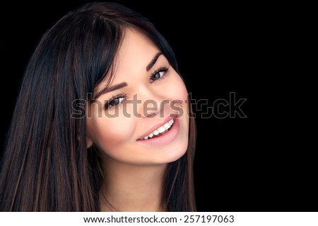 Beautiful Smiling Young Woman Portrait. Beauty Healthy Smile with White Teeth.  Over Black  background . Laughing Girl. Perfect Skin. - stock photo