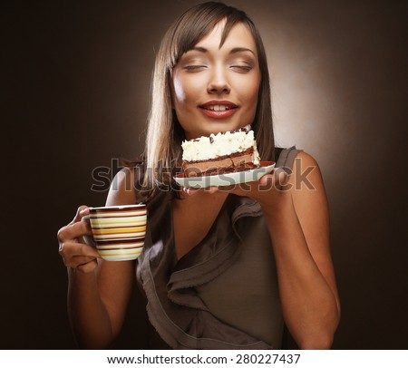 beautiful smiling young woman with a cake and coffee - stock photo