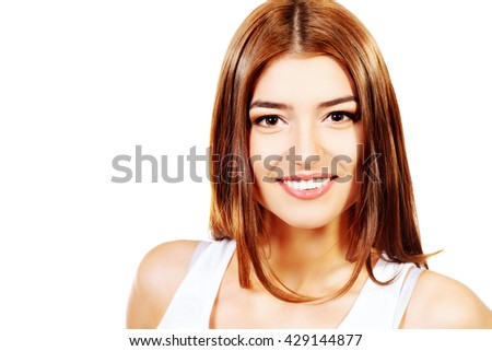 Beautiful smiling young woman with fresh pure skin. Healthcare. Copy space. Isolated over white. - stock photo