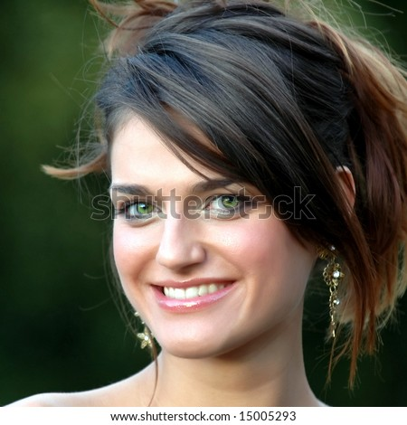 Beautiful smiling young woman with green eyes on green background 03 - stock photo