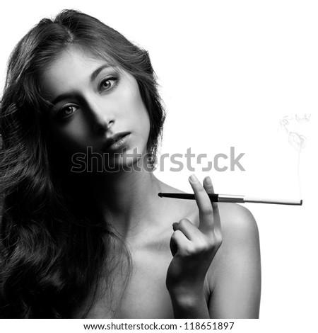 Beautiful smoking woman. BW Image - stock photo
