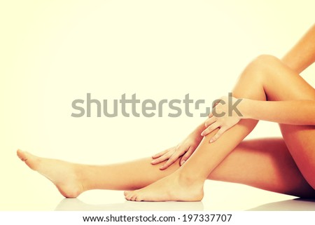 Beautiful, smooth female legs and feet. - stock photo
