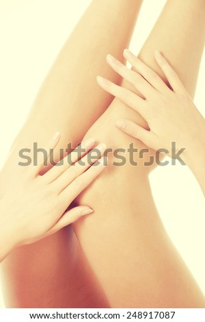 Beautiful smooth female legs streteched up. - stock photo