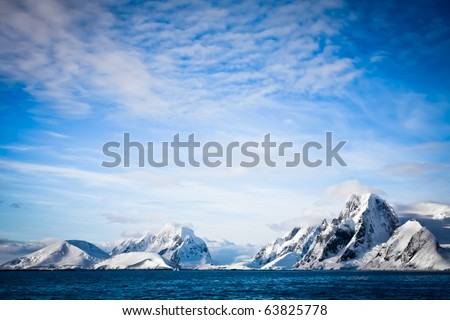 Beautiful snow-capped mountains against the blue sky - stock photo